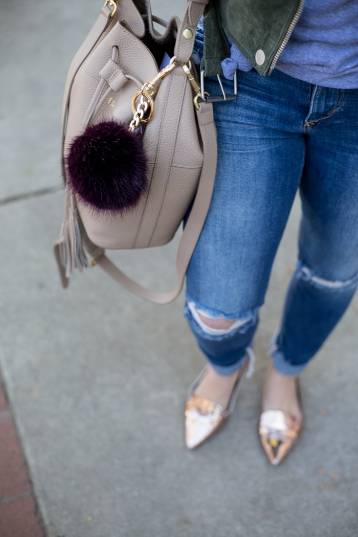 Distressed Skinny Jeans, Rose Gold Flat Loafers, Bucket Bag, Pom Pom Bag Charm - via @maeamor