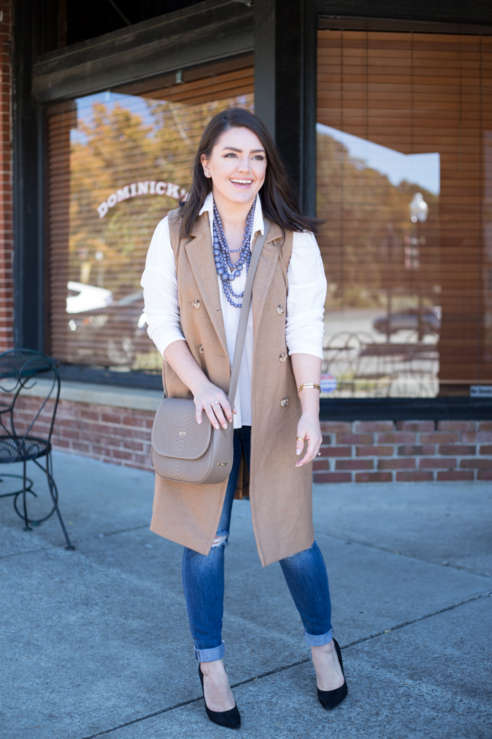Sleeveless coat and layered strands - via @maeamor