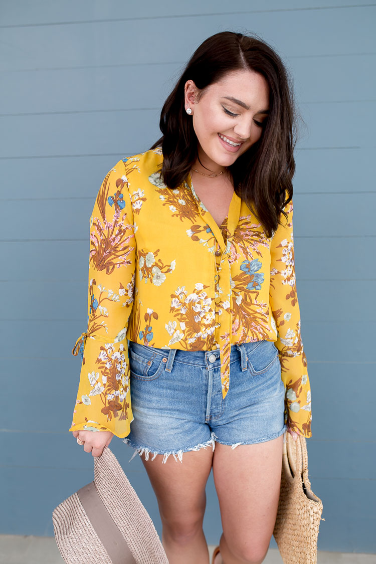 Yellow Floral Bell Sleeve Blouse | Mauve Suede Knot Slides | Straw Bag | High Waisted Denim Cutoffs | Straw Hat | via @maeamor